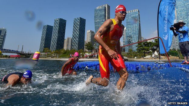 China's Bai Faquan competing in a triathlon