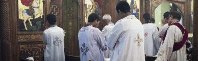 Egyptian Coptic clerics attend a Friday Mass at the Virgin Mary church on 16 May, 2014