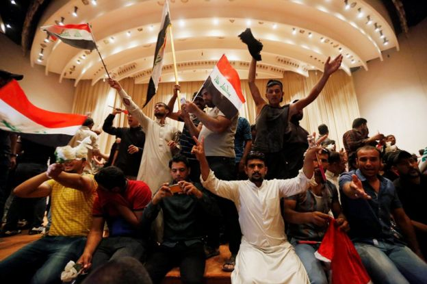 Followers of Moqtada al-Sadr are seen in the parliament building 30 April