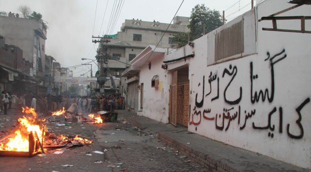 Riot outside a Christian girls' school in Lahore after a teacher was accused of blaspheming against Islam