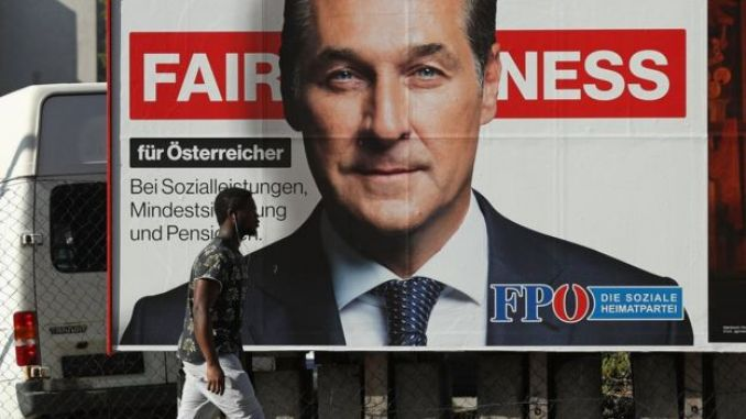 A man walks past an election campaign billboard that shows Heinz-Christian Strache of the far-right Freedom Party