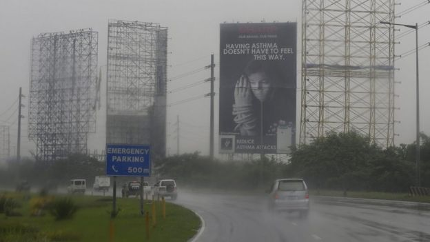 Giant billboards removed in anticipation of typhoon in town of Meycauyan, Bulacan province, Philippines, 17 October 2015.