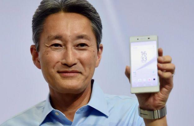 Kazuo Hirai holds up a Sony Xperia phone