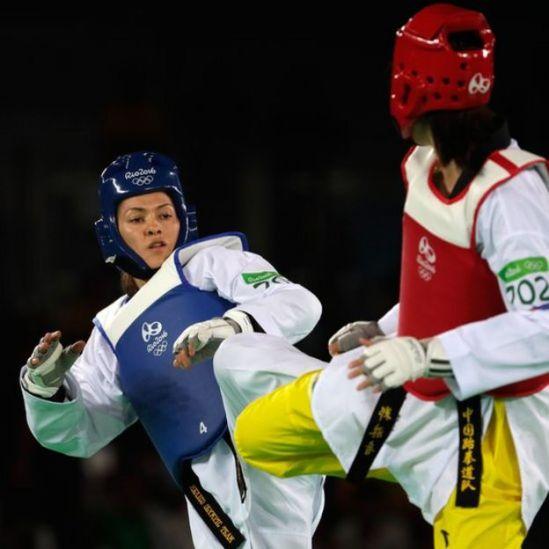 Espinoza y Zheng en acción