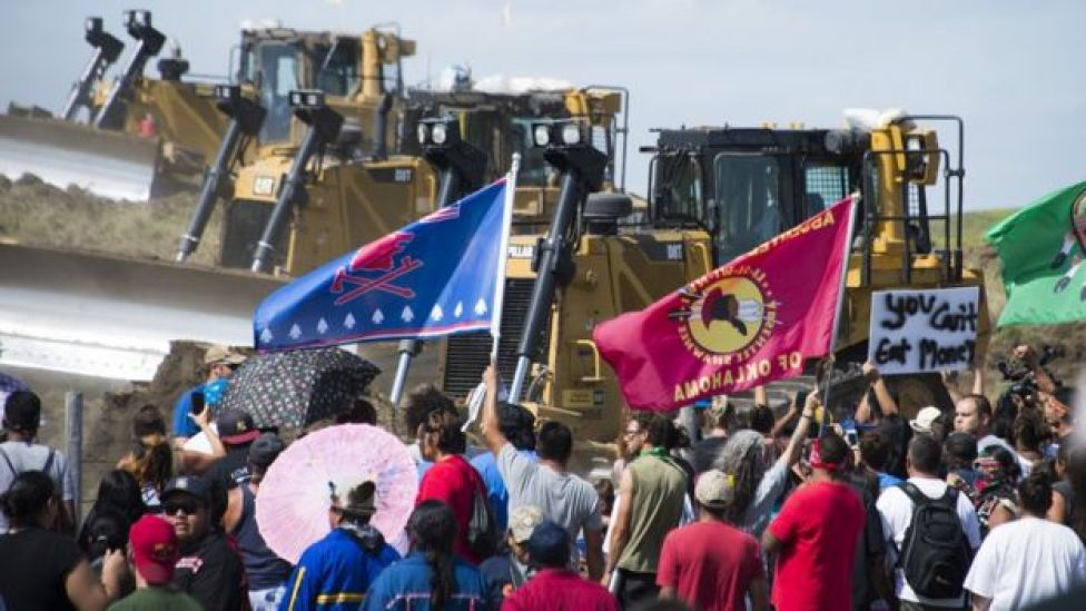 Members of the Standing Rock Sioux Tribe and their supporters opposed to the Dakota Access Pipeline confront bulldozers working at the site, 3 September 2016