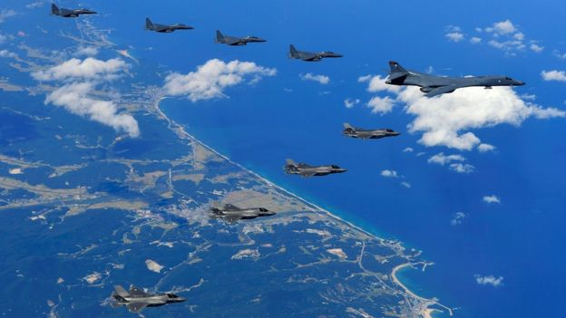A US Air Force B-1B Lancer bomber (R), US F-35B stealth jet fighters (bottom) and South Korean F-15K fighter jets (top) flying over South Korea during a joint military drill