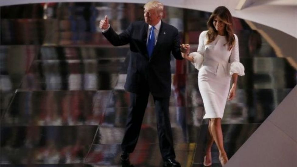 Donald Trump leaves the stage with his wife Melania after she spoke at the Republican National Convention in Cleveland, Ohio, U.S., July 18, 2016