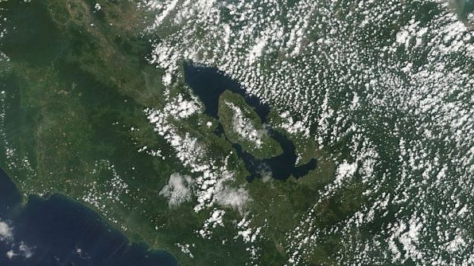 Satellite image of a long oval lake with a central island