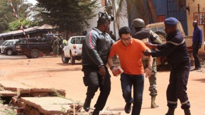 Security helps a hostage flee a siege in Mali's capital Bamako