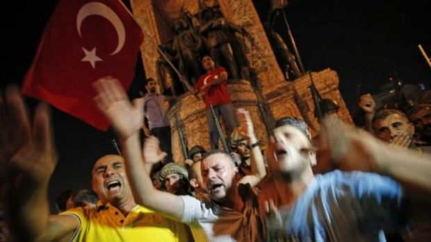Erdogan supporters protest in front of soldiers on Istanbul's Taksim Square. Photo: 16 July 2016