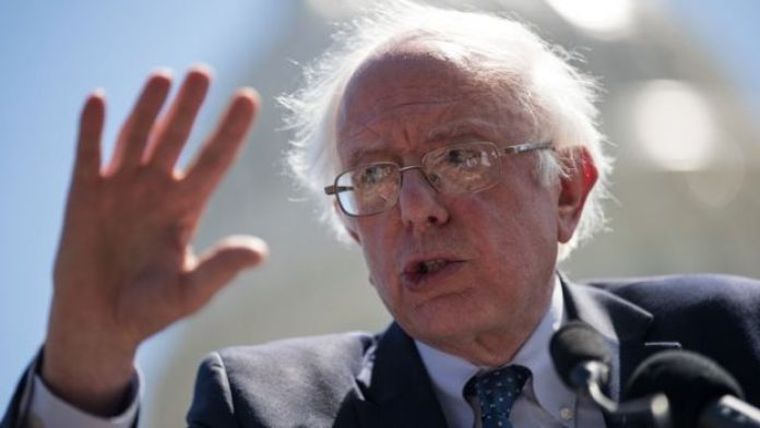 Bernie Sanders speaks outside the Capitol.