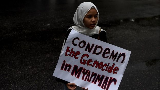In this file picture taken on November 25, 2016 a Malaysian Muslim girl holds a placard following a protest against the persecution of ethnic Rohingya Muslims in Myanmar, outside the Myanmar Embassy in Kuala Lumpu