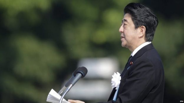 Japanese Prime Minister Shinzo Abe delivers a speech during the peace memorial ceremony marking the 70th anniversary of the nuclear bombing of the city at Hiroshima Peace Memorial Park