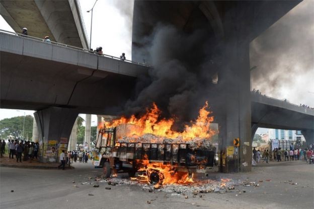A truck from neighbouring state Tamil Nadu burns after it was set alight by agitated pro-Karnataka activists as the Cauvery water dispute erupted following the Supreme Court