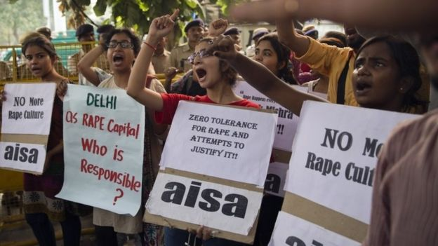 Indian students shout slogans during a protest against the latest incidents of rape in New Delhi, India, Sunday, Oct. 18, 2015