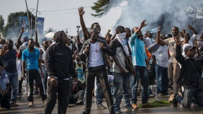 Supporters of Gabonese opposition leader Jean Ping face at a demonstration in the capital in Libreville in 2016