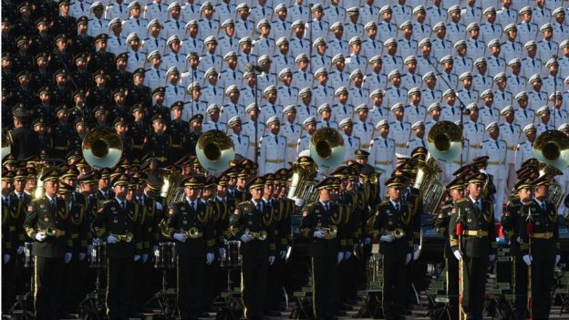 A Chinese military brass band (front) and choir stand in position ahead of a military parade later in the morning at Tiananmen Square in Beijing on 3 September 2015, to mark the 70th anniversary of victory over Japan and the end of World War II.