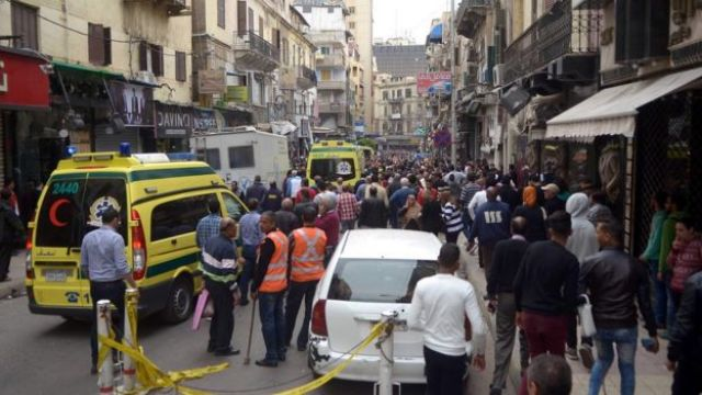 Egyptians gather at near a church in Alexandria after a bomb blast struck worshippers gathering to celebrate Palm Sunday