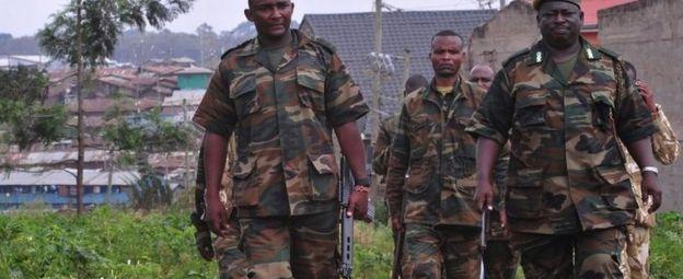 Kenya Wildlife Service (KWS) officers carrying tranquilizer guns