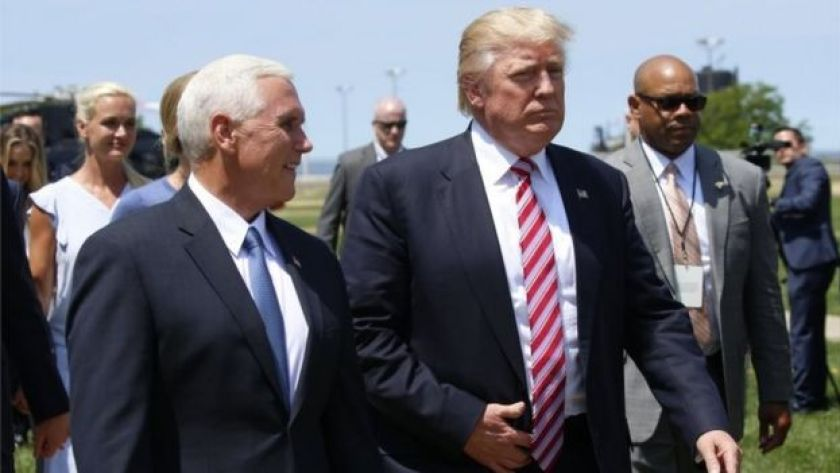 Donald Trump walks with vice-presidential nominee Mike Pence after arriving in Cleveland, Ohio, (20 July 2016)