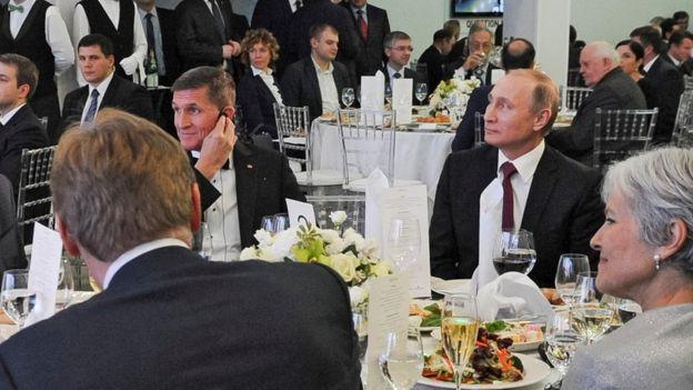 In this file photo taken on Thursday, Dec. 10, 2015, Russian President Vladimir Putin, center right, with retired U.S. Lt. Gen. Michael T. Flynn, center left,