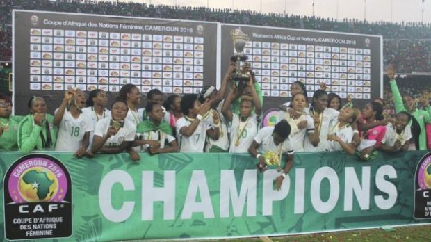 Nigeria soccer players and team officials celebrate