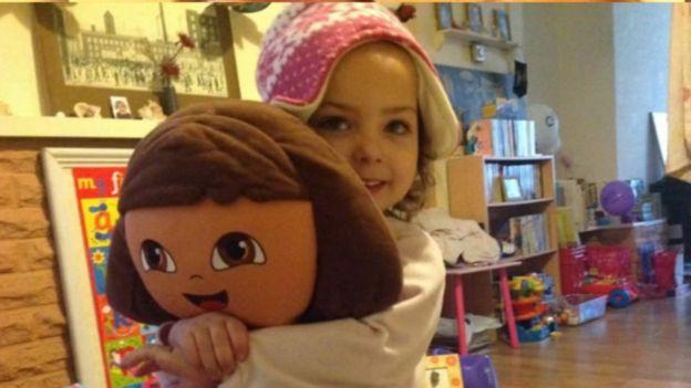 Poppy Widdison holding doll