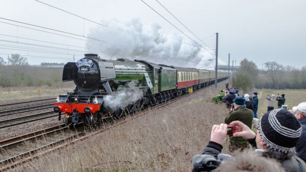 Spectators taking photos of Flying Scotsman