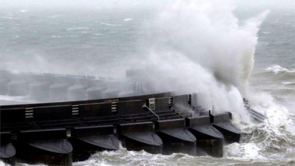 Waves crash over marina wall in Brighton