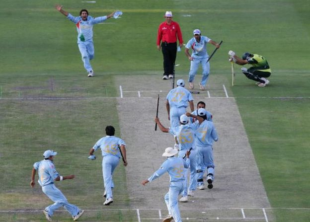 The Indian Team celebrate their win with Misbah-ul-Haq looking on after the Twenty20 Championship Final match between Pakistan and India at The Wanderers Stadium on September 24, 2007 in Johannesburg, South Africa