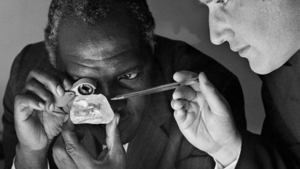 Davidson Nicol (L) High commissioner of London, and Anthony Oppenheimer (R) of the central selling organisation, studying the third largest diamond of the world