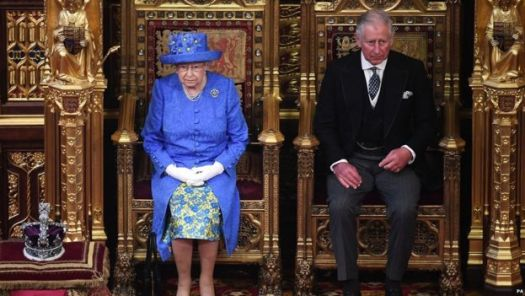 The Queen accompanied by Prince Charles