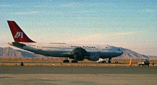 A hijacked Indian Airlines jetliner parks on the tarmac of Kandahar airport in southern Afghanistan on Sunday December 26, 1999.