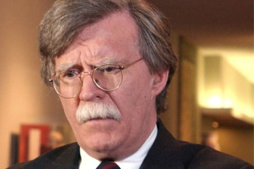 John Bolton listens to a reporter's question at UN headquarters, 10 October 2006