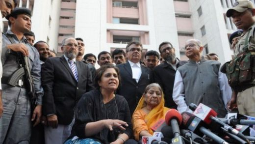 Indian widow Zakia Jafri (C/R in saree) listens as activist, Teesta Setalvad (C/L) addresses media representatives outside a court in Ahmedabad on December 26, 2013, following a judgement in favour of Chief Minister of Gujarat Narendra Modi over his role in 2002 religious riots