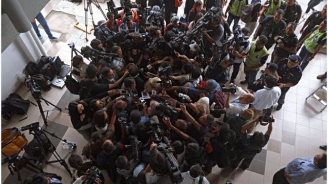 Shot from above of Gooi Soon Seng, the lawyer who represents Siti Aisyah, surrounded by camera operators and journalists, in the Sepang Magistrate Court building on 1 March 2017 in Sepang, Malaysia.