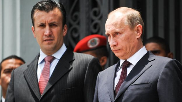 Photo taken on 2 April 2010 shows Venezuelan Interior Minister Tareck El Aissami (L) and then Russian PM Vladimir Putin