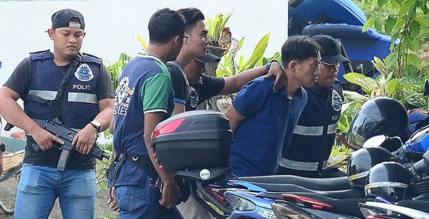 A North Korean man (second right) identified by the Malaysian police as Ri Jon-chol is taken to a police station in Sepang, Malaysia, February 18, 2017.