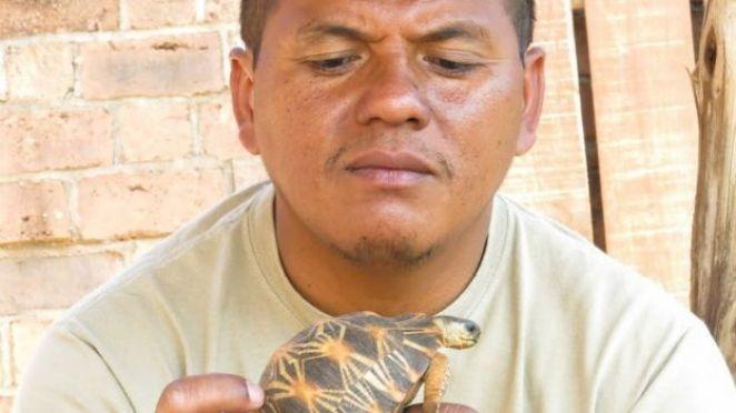 Herilala Randriamahazo, TSA's coordinator in Madagascar, with a Radiated Tortoise.