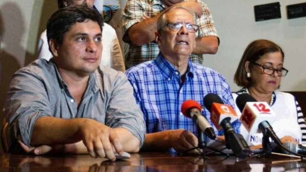 Representatives of the opposition Frente Amplio por la Democracia party Eliseo Nunez (2nd L), Violeta Granera (R) and Carlos Noguera attend a press conference after the closing of the voting during presidential elections, on November 6, 2016.
