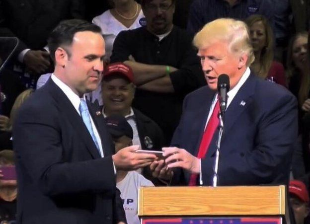 Dan Scavino Jr. appears with Donald Trump at a presidential campaign rally in this undated Facebook photo.