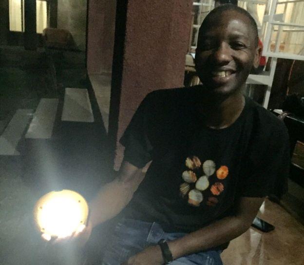 Man holding a solar lamp