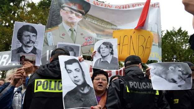 Protestors holding pictures of Gen Wojciech Jaruzelski' Martial Law