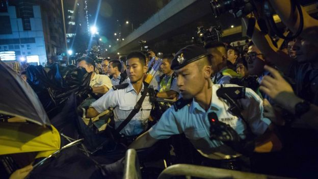 Police use pepper spray to stop protesters charging outside the Chinese Liason Office in Hong Kong on 6 November 2016, during a protest against an expected interpretation of the city's constitution - the Basic Law - by China's National People