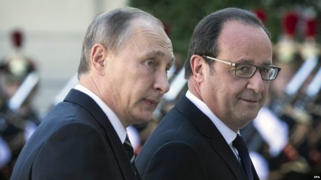 Russian President Vladimir Putin (L) is welcomed by French President Francois Hollande (R) as he arrives at the Elysee Palace for a summit on Ukraine, in Paris, France, 02 October 2015