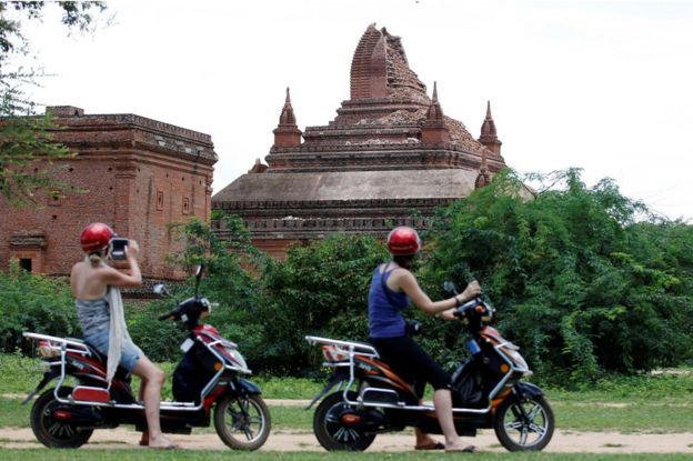 Tourists take pictures of a damaged pagoda after an earthquake in Bagan, Myanmar, 25 August 2016