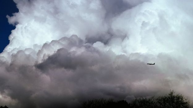 Plane flying through clouds