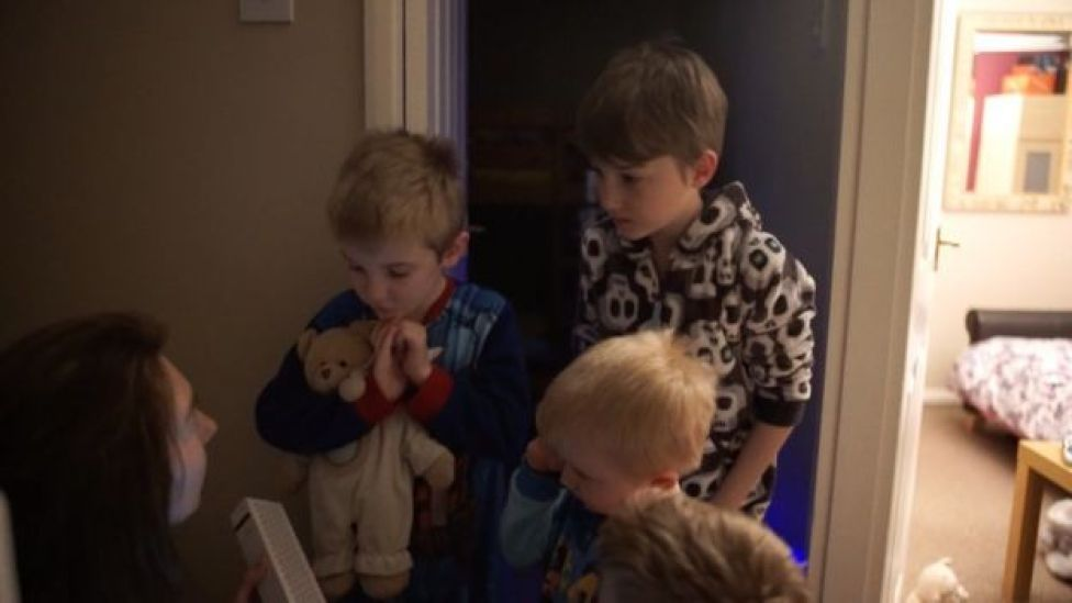 Mum talking to four boys