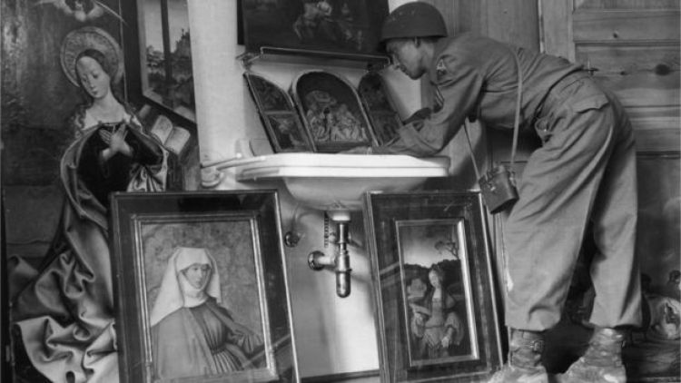 American servicemen view art treasures on show at a former Luftwaffe barracks near Konigsee - paintings looted from all parts of Europe under orders from Hermann Goering, the head of the Luftwaffe: May 1945