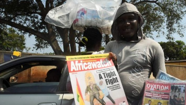 A street vendor shows copies of Ghanaian magazines with election headlines